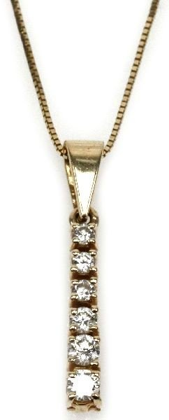 LADIES 14K YELLOW GOLD AND DIAMOND PENDANT 0.5 CTS