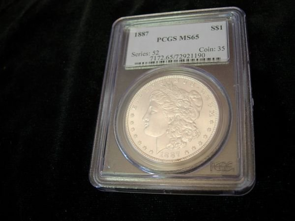 32: 1887 MORGAN SILVER DOLLAR MS65 PCGS