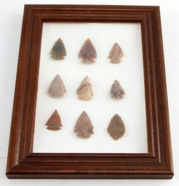 LOT OF 9 SMALL ARROWHEADS IN WOODEN FRAME