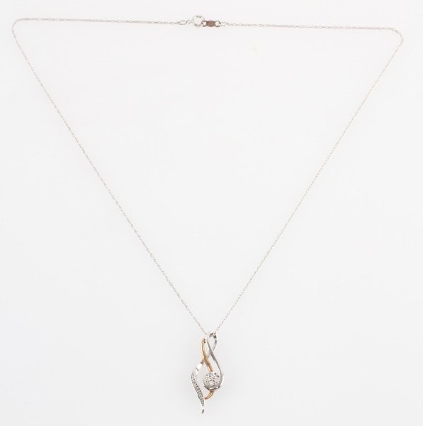 STERLING AND GOLD PENANT ON SILVER CHAIN