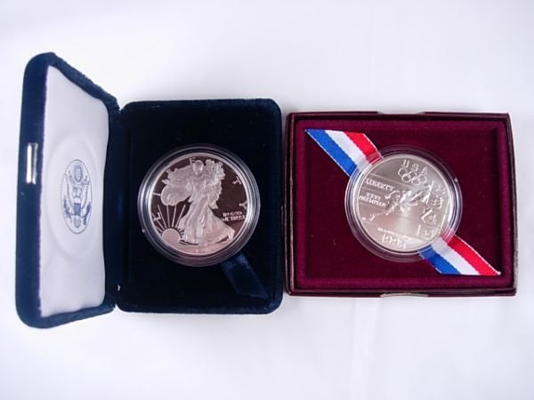 260: 1995 MINT LOT OF 2 SILVER DOLLARS OLYMPIC & EAGLE