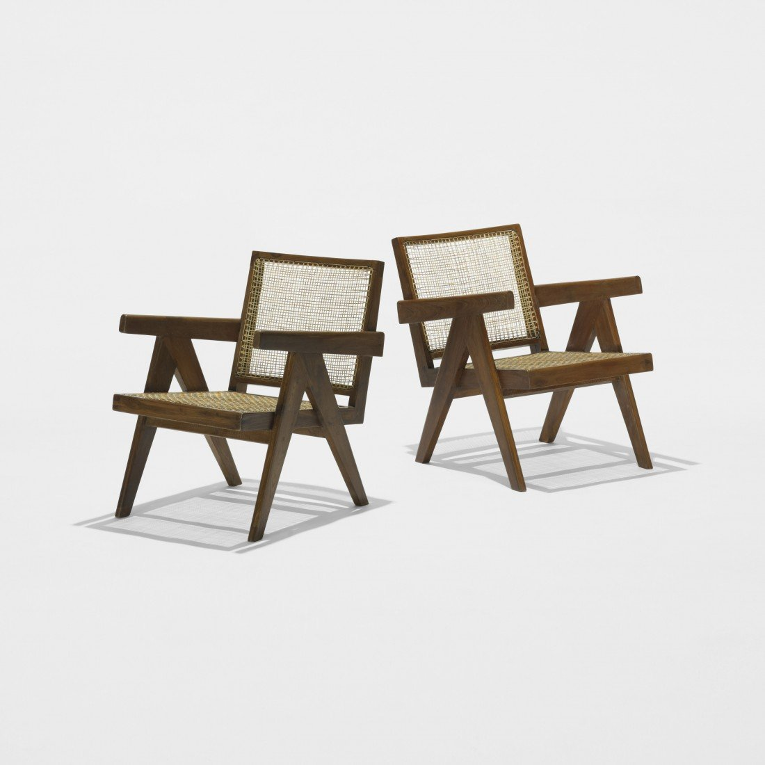 169: Pierre Jeanneret pair of lounge chairs