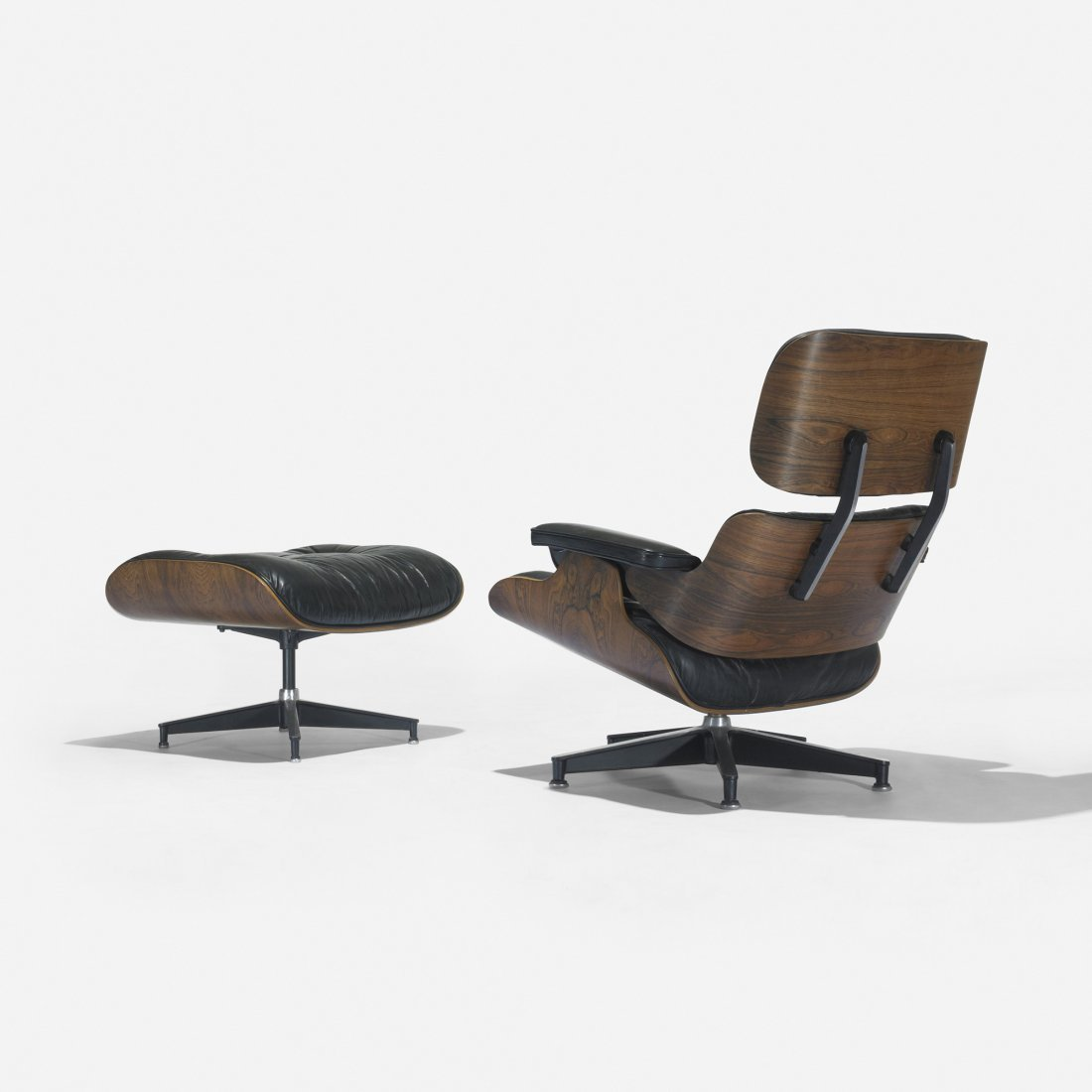113: Eames 670 lounge chairs and 671 ottoman