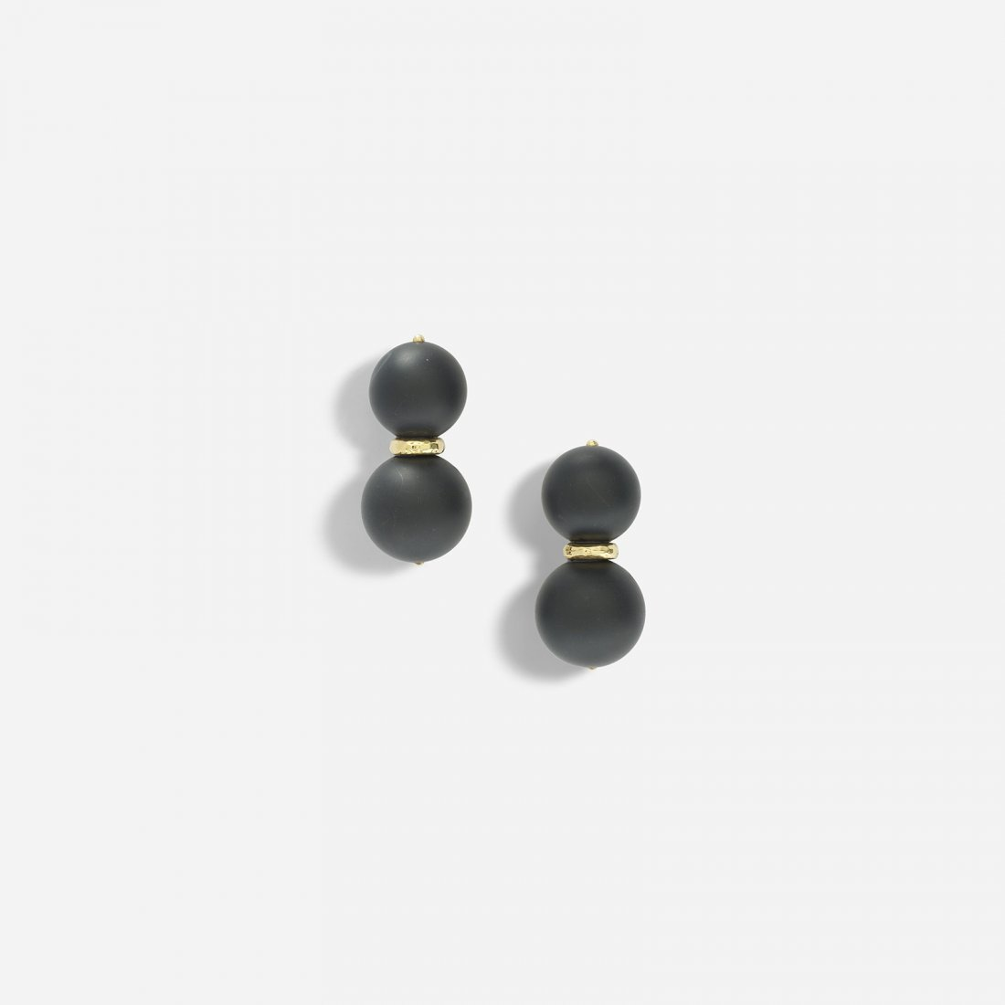 Andrew Clunn a pair of gold and onyx earrings