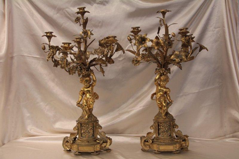 Pair of Bronze Six Light Figural Candelabras