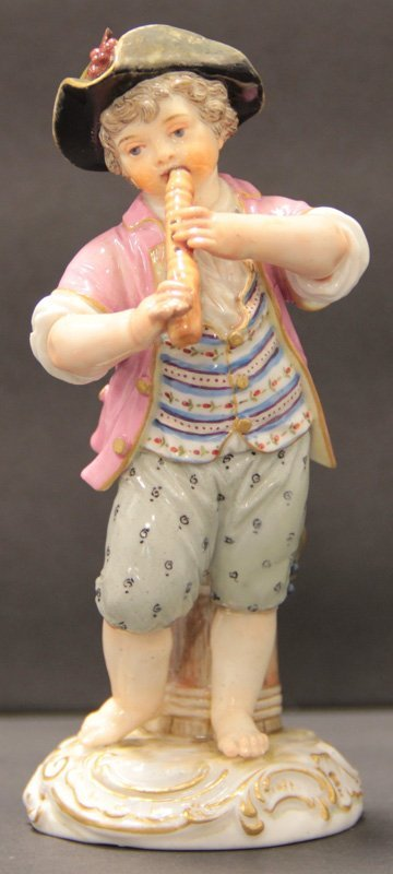 MEISSEN PORCELAIN FIGURE OF A BOY PLAYING A FLUTE