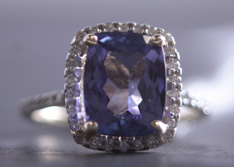 14 kt YG  4.18 ct Tanzanite & .56 ct Diamond Ring