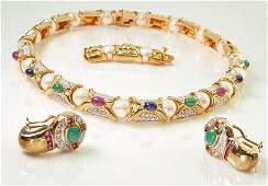 This is a contemporary 18k yellow gold, multi colored