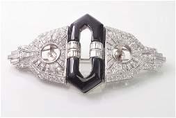 exquisite Art Deco diamond, onyx and platinum double