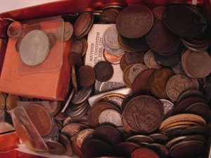 216: Nice box of foreign coins; some old with silver