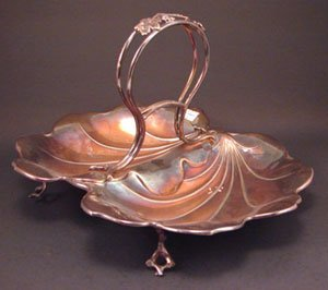 "1011: Silver plate Leaf form serving tray. 8""h x 13 1/4"