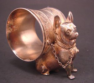 1012: Two silver plate figural dog napkin rings. 2 1/2""