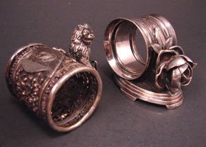 1012A: Two Figural Silver Plate Napkin Rings. one lion,