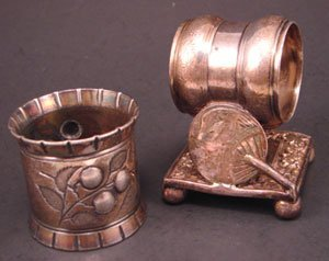 "1012C: Two Silver Plate Napkin Rings. One signed ""Merid"