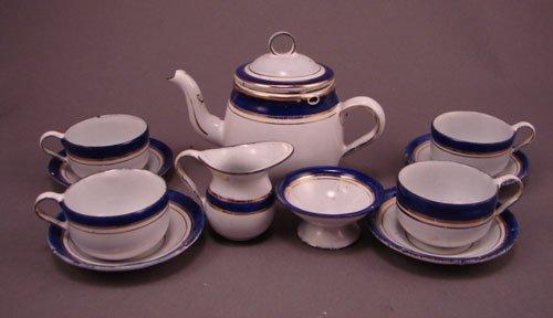 11010: Childs Miniature Enamel Ware Tea Set with blue a