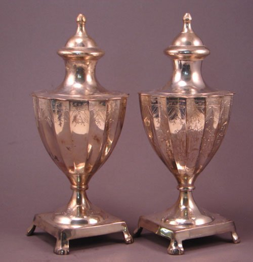 "012A: Pair of silver plate urns. 9 1/2""h x 4 1/4"" diame"