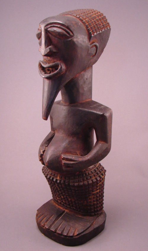 "1003: Bakuba Zaire Carved Sculpture. 14 3/4""h x 4 1/2""w"