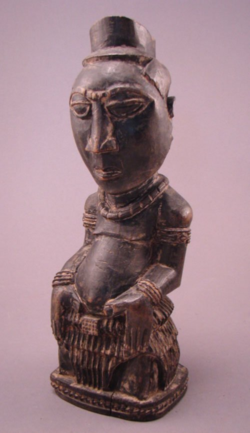 1007: Kuba, SE Zaire Carved Sculpture. Seated man. 10 3
