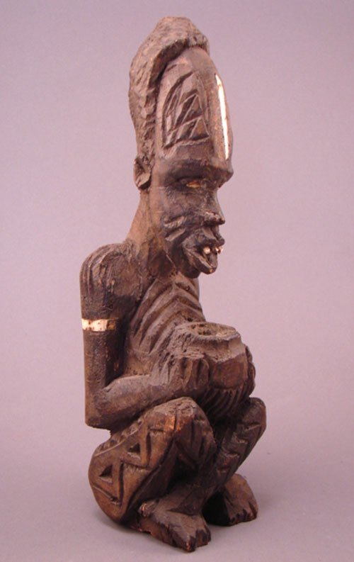 1008: Kuba, Zaire fetish with incense burner, Carved Sc