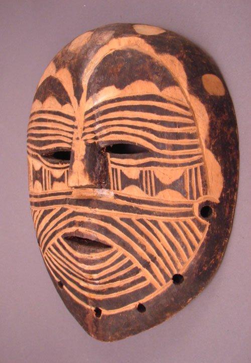 "1017: African Mask. Batetela. 10 3/4""h x 8 3/4""w x 2""d."
