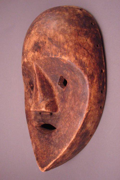 "1018: Lega Congo Carved Mask. 13 3/4""h x 8 1/4""w x 3 1/"