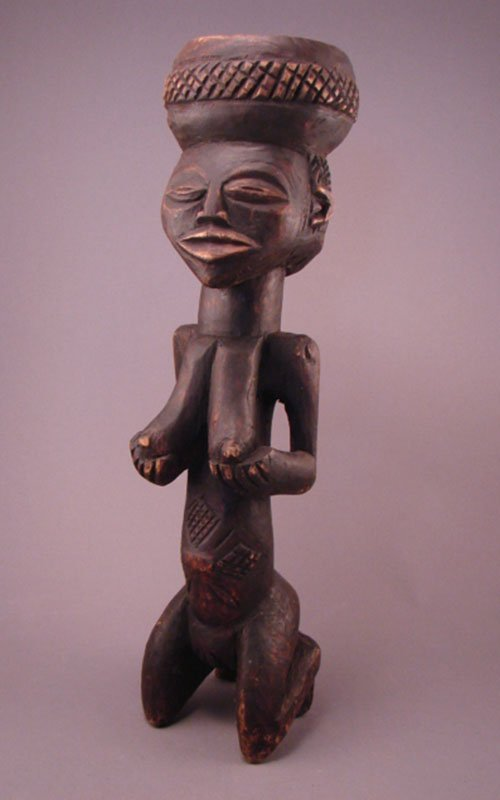 "1021: Kuba, Carved Sculpture. 17 3/4""h x 4 3/4""w x 3 1/"