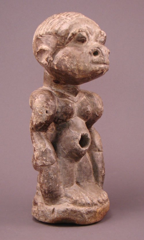 1126: African Stone Carving. Fetish figure with hollowe