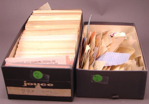 5003: Two boxes of foreign stamps: first box has dozens