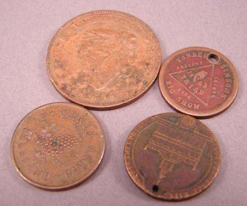 5210: Four U.S. tokens . (2 holed) AG-F