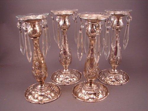 6015: 4 Rococo sterling silver candllesticks / holder
