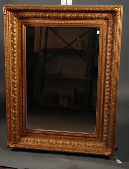 1003: Gilt gesso over wood hanging mirror