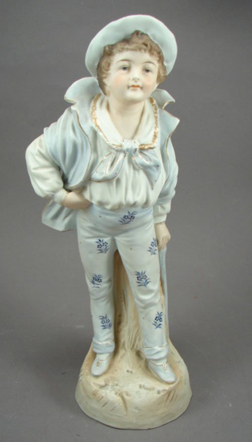 1006: Hand Painted Biscuit Porcelain Figurine, boy with