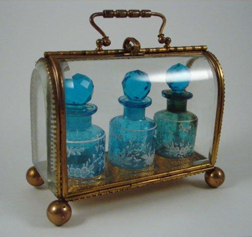 2002: Antique European Cologne Set with three enamel gl