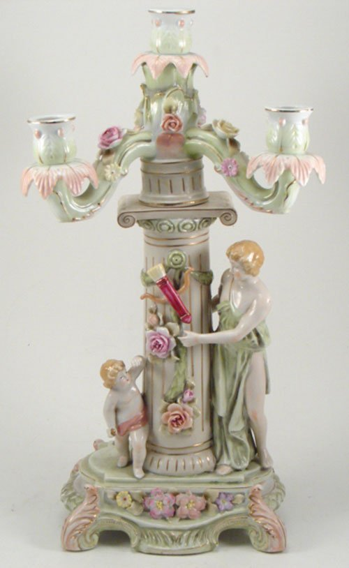 2009: Figural Hand Painted Porcelain Candelabrum with C