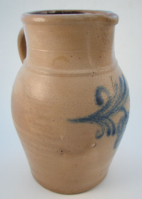 1002: Antique Stoneware One Gallon Pitcher with Folk ar