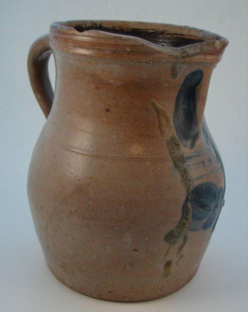 1009: Penn Yan Antique Stoneware Jug with folk art blue