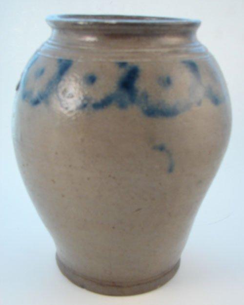 1011: Antique Stoneware Jar with folk art blue decorati