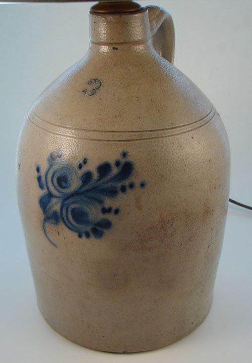 1013: Antique 2 gallon Stoneware Jug with folk art blue