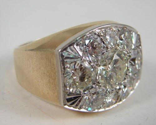2031: Men's Diamond & Yellow Gold Ring. Ring is mounted