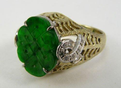 2022: 18k Jade Ring with 16 small single cut diamonds.