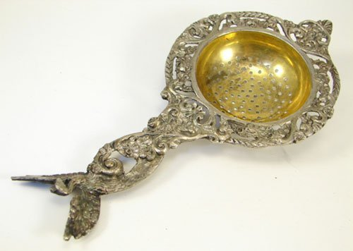 19: Antique Cast Silver Plated Tea Strainer with Peacoc