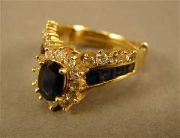 142: Ladies 14k Yellow Gold Diamond & Dark Blue Sapphir