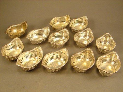 22: Gorham Sterling Nut Dish Set with pierced sides. 12