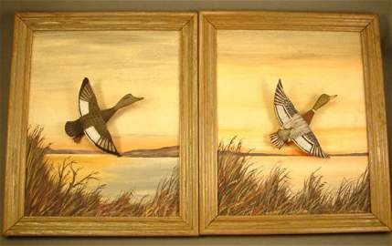1204: Pair of Signed Conklin duck carvings, framed. ss: