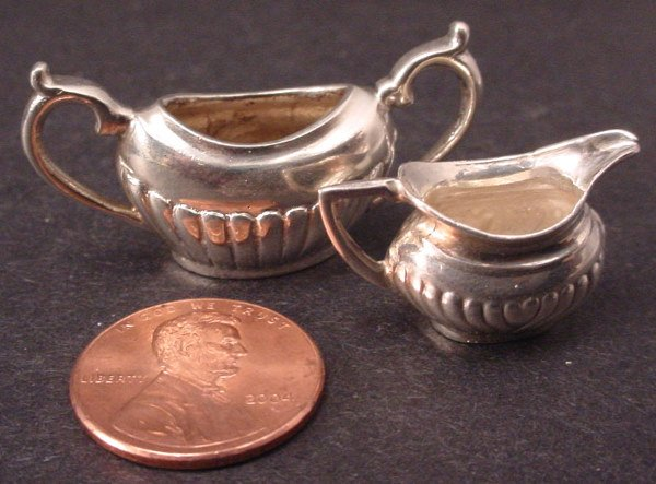 21A: Two Sterling Silver miniatures include open sugar