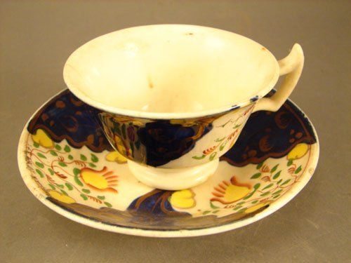 9: Gaudy Ironstone Antique Tea Cup and Deep Saucer. 19t