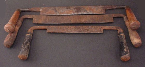 """Three Draw Knives with wooden handles. 19""""w."""