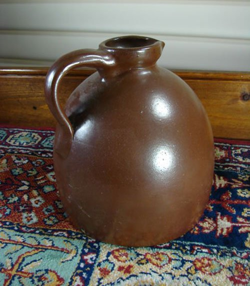 7: Small Antique Stoneware Jug with pouring spout in br