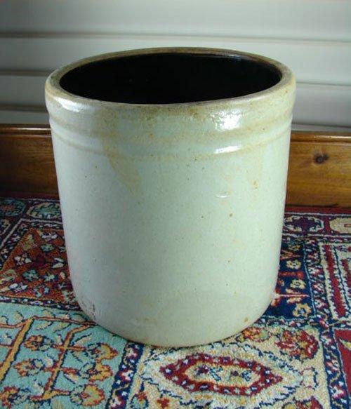 "15: Antique Stoneware Crock. Some glaze flaws. 9 1/2"" h"