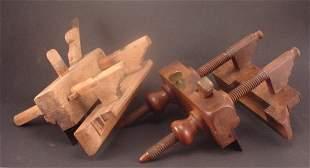 "Pair Plow planes. ""Auburn NY"" on lighter wood pla"